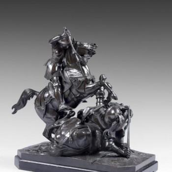 Théodore GECHTER (1796-1844) Jeanne d'Arc combattant un chevalier anglais, 1841. Epreuve en bronze à patine verte et noire, signée et datée sur la terrasse. Socle rectangulaire à pans coupés en bois noirci. 49 x 41 x 23 cm.
